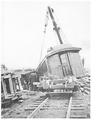Derrick OP raising a coach back to the track.  Derailment just north of Espanola depot.<br /> D&amp;RG  Espanola, NM  1921