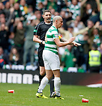 Scott Brown tosses a coin he picks up