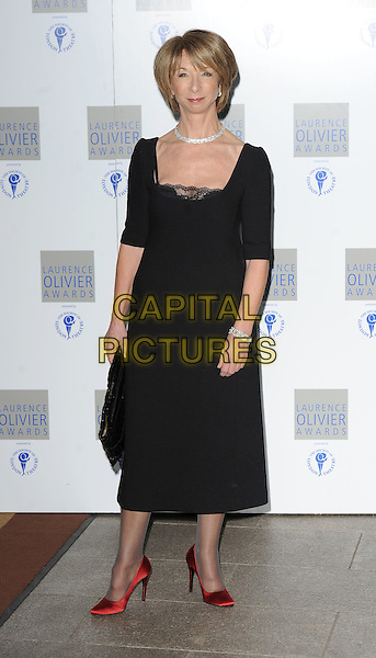 HELEN WORTH.The Laurence Olivier Awards 2010, Grosvenor House Hotel, London, England. .21st March 2010 .full length black dress lace diamond bracelet necklace choker red silk satin shoes clutch bag.CAP/BEL.©Tom Belcher/Capital Pictures.
