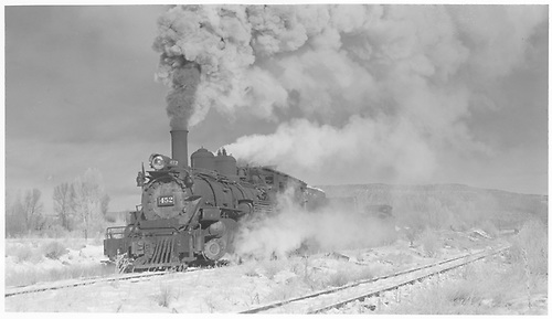 3/4 view of K-27 #452 leaving Ridgway pulling gondolas and 0400.<br /> RGS  Ridgway, CO  Taken by Richardson, Robert W. - 11/18/1951