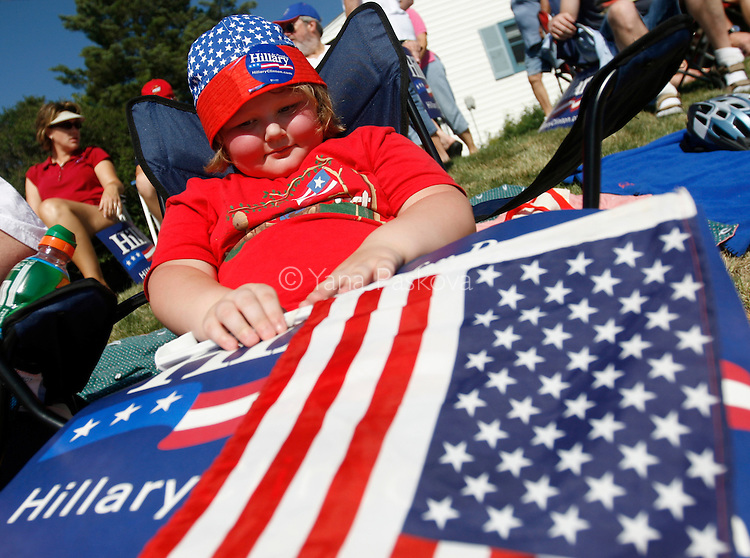 A young girl carries a sign for Democratic Presidential hopeful Hillary Clinton (D-NY). The former first lady brought along her husband, former President Bill Clinton, as she campaigned at the Clear Lake 4th of July Parade in Clear Lake, Iowa, on July 4, 2007.