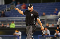 Umpire Dane Ponczak signals fair ball during a game between the West Virginia Black Bears and Batavia Muckdogs on June 28, 2016 at Dwyer Stadium in Batavia, New York.  Batavia defeated West Virginia 3-1.  (Mike Janes/Four Seam Images)