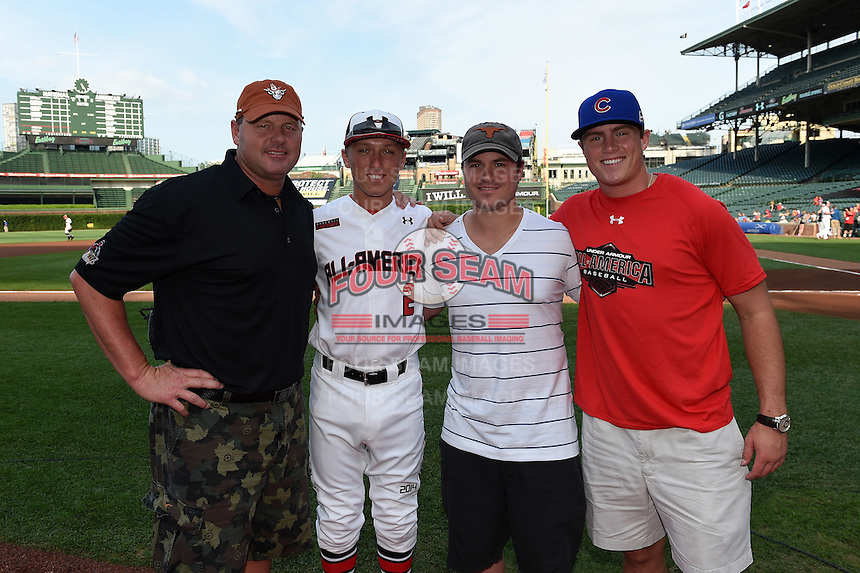 Former MLB pitcher Roger Clemens poses with his three sons Kody Clemens (2), Koby Clemens (white), and Kacy Clemens (red) before the Under Armour All-American Game on August 16, 2014 at Wrigley Field in Chicago, Illinois. Kody is one of the top high school prospects in the nation while Koby played minor league baseball for the Houston Astros and Toronto Blue Jays organizations and Kacy currently is a first baseman for the Texas Longhorns. (Mike Janes/Four Seam Images)