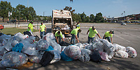 NWA Democrat-Gazette/J.T. WAMPLER A crew from the University of Arkansas' facilities management pack a truck with garbage Sunday Sept. 10, 2017 while cleaning up after the home football game on Saturday. The crew of six men picked up 8 to 10 tons of garbage just from the tailgating areas of campus. They started at 7:00 A.M. and had two trucks loaded with the trash by 11:00, moving over a ton of garbage each.