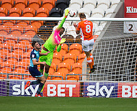 Jamal Blackman of Wycombe Wanderers rises highest to palm away a cross before Brad Potts of Blackpool can head home during the Sky Bet League 2 match between Blackpool and Wycombe Wanderers at Bloomfield Road, Blackpool, England on 20 August 2016. Photo by James Williamson / PRiME Media Images.