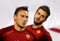 Calcio, Serie A: Roma vs Lazio. Roma, Stadio Olimpico, 8 aprile 2013..AS Roma forward Francesco Totti, left, and midfielder Miralem Pjanic, of Bosnia, warm up prior to the start of the Italian serie A football match between A.S. Roma  and Lazio at Rome's Olympic stadium, 8 april 2013..UPDATE IMAGES PRESS/Riccardo De Luca