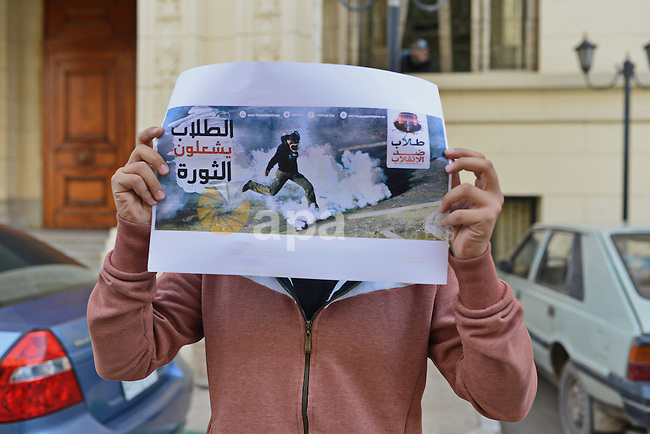 Egyptian students who support Muslim Brotherhood and ousted president Mohammed Morsi, take part in a demonstration to demand for release the detained students, at Cairo University, in Cairo, Dec. 02, 2014. Photo by Amr Sayed