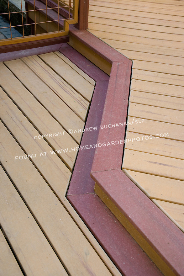 There are now more than 70 companies producing composite decking materials, usually made from recycled plastic, wood scraps, and resins, although Trex was the first company to do so.  Composites come in a range of colors, textures, dimensions, styles, and simulated wood grains that can be matched together, cut to any size, and cut, joined, and scribed like wood as in this detail of a colored edge trim marking the change in elevation between two levels of the deck.
