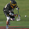 Kevin Snyder #35 of Commack pounces on a loose ball during the Suffolk County varsity boys lacrosse Division I (Class A) quarterfinals against host Half Hollow Hills High School East on Friday, May 19, 2017. Hills East won by a score of 11-9.