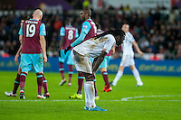 Bafetibis Gomis of Swansea with his head down during the Barclays Premier League match between Swansea City and West Ham United played at the Liberty Stadium, Swansea  on December 20th 2015