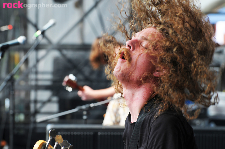 Bassist Zach Westphal from Baltimore rock band J Roddy Walston and the Business performs at the Pool Parties Concert in McCarren Park, Brooklyn NYC.