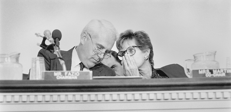 Rep. Victor Herbert Fazio, D-Calif., House Democratic Caucus Vice Chairman, and Rep. Lynn Morley Martin, R-Ill., whispering at an Ethics Task Force hearing. 1989 (Photo by Laura Patterson/CQ Roll Call)