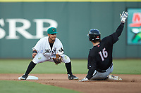 Augusta GreenJackets shortstop Anyesber Sivira (40) waits to apply the tag to Michael Hickman (16) of the Kannapolis Intimidators as he slides into second base at SRG Park on July 6, 2019 in North Augusta, South Carolina. The Intimidators defeated the GreenJackets 9-5. (Brian Westerholt/Four Seam Images)