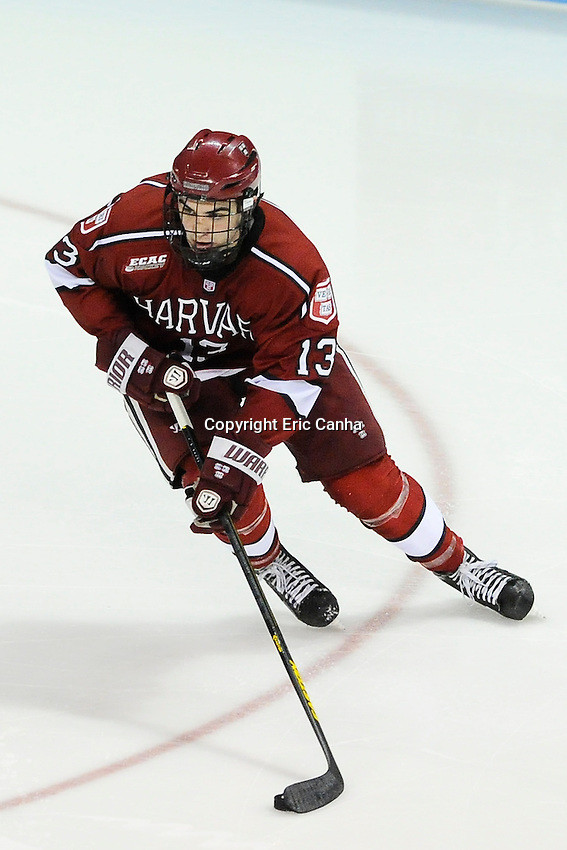Harvard Crimson forward Tommy O'Regan (13) during the Harvard University at Boston University NCAA hockey match held at the Agganis Arena in Boston Massachusetts.   Eric Canha/CSM