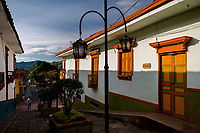Brightly painted wooden balconies and windows are seen at a colonial house during the sunrise in Jericó, a village in the coffee region (Zona cafetera) of Colombia, 24 April 2018.