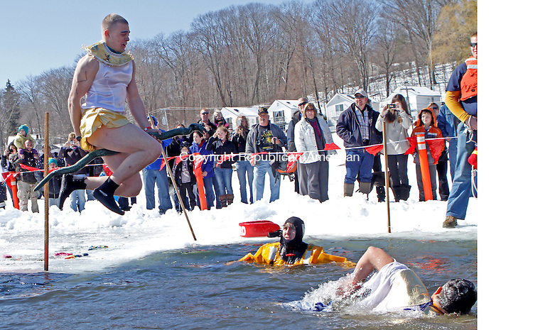 Winsted, CT-030913MK19 A member of team 'I want my Mummy' leaps into the thirty-two degree water in Highland Lake during the annual Penguin Plunge on Saturday afternoon in Winsted. Sharon Pelkey, director of development northwest region, said that there were one-hundred forty-eight jumpers and the event raised over $54,500 for the Special Olympics. Michael Kabelka Republican American