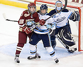 Emily Field (BC - 15), Kelly McDonald (Maine - 14), Brittany Ott (Maine - 29) - The visiting University of Maine Black Bears defeated the Boston College Eagles 5-2 on Sunday, October 30, 2011, at Kelley Rink in Conte Forum in Chestnut Hill, Massachusetts.