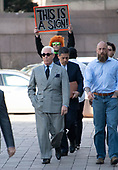 Former adviser to United States President Donald J. Trump, Roger Stone, is followed by a man with a sign as he walk to the entrance of the US District Court in Washington, DC on Thursday, March 14, 2019. <br /> Credit: Ron Sachs / CNP<br /> (RESTRICTION: NO New York or New Jersey Newspapers or newspapers within a 75 mile radius of New York City)