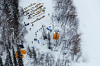 This aeriel photo shows a team arriving as others rest at the Eagle Island checkpoint on Saturday March 9th during the 2019 Iditarod Trail Sled Dog Race.<br /> <br /> Photo by Jeff Schultz/  (C) 2019  ALL RIGHTS RESERVED