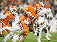 Charlotte, NC - December 2, 2017: Clemson Tigers wide receiver Hunter Renfrow (13) gets tackled during the ACC championship game between Miami and Clemson at Bank of America Stadium in Charlotte, NC.  (Photo by Elliott Brown/Media Images International) Clemson defeated Miami 38-3 for their third consecutive championship title.