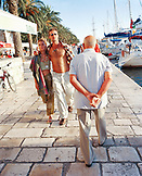 CROATIA, Hvar, Dalmatian Coast, tourist walking along the yacht marina in Hvar Island.