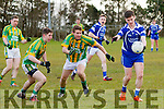 Renard's Conor O'Leary is afforded a little space from Lispole's Daragh Brosnan & Brendan Dorgan and makes no mistake as he takes his point.