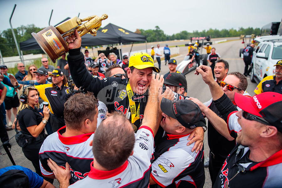 Aug 19, 2018; Brainerd, MN, USA; NHRA top fuel driver Billy Torrence celebrates with crew members after winning the Lucas Oil Nationals at Brainerd International Raceway. Mandatory Credit: Mark J. Rebilas-USA TODAY Sports