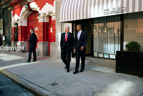 President Barack Obama and former President Bill Clinton leave a  lunch at a Greenwich Village restaurant, after the President's speech at Federal Hall on Wall Street, New York, N.Y., Sept. 14, 2009.  (Official White House Photo by Pete Souza)<br /> <br /> This official White House photograph is being made available only for publication by news organizations and/or for personal use printing by the subject(s) of the photograph. The photograph may not be manipulated in any way and may not be used in commercial or political materials, advertisements, emails, products, promotions that in any way suggests approval or endorsement of the President, the First Family, or the White House.