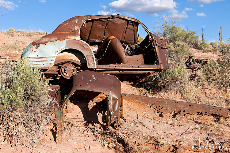A rusted auto and pickup truck along the banks of Dead Wash in Arizona along an abandoned alignment of Route 66.
