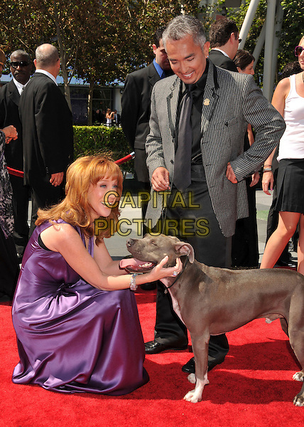KATHY GRIFFIN & CESAR MILLAN.61st Annual Creative Arts Emmy Awards held at Nokia Theatre LA Live, Los Angeles, California, USA, .12th September 2009..emmys full length bending down stroking petting dog pet animal purple silk satin dress .CAP/ADM/BP.©Byron Purvis/Admedia/Capital Pictures