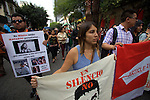 Hundreds of journalists attend a gathering to protest against the assassination of the Mexican photojournalist Ruben Espinosa, in front of the Monument to the Independence in Mexico City, August 2, 2015. Espinosa had fled from the eastern state of Veracruz some weeks ago, after being threatened for his work as journalist.  Four women were found also murdered in an apartment in a Mexico city's middle-class neighborhood. Photo by Heriberto Rodriguez