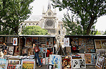 Artists stalls on the left bank of the river Seine, with the Cathedral of Notre- Dame in the background. Paris, France.