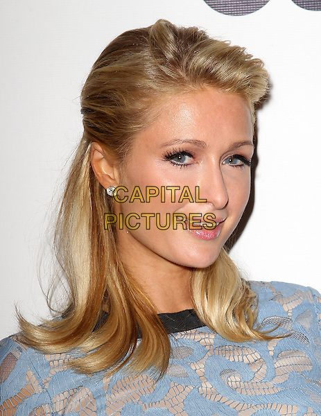 Paris Hilton.OUT Celebrates LA Fashion Week With OUT Fashion Benefitting The AIDS Healthcare Foundation_Show  Held At The Pacific Design Center, Los Angeles, California, USA, 7th March 2013..portrait headshot blue  cream print top patterned lace  black trim .CAP/ADM/FS.©Faye Sadou/AdMedia/Capital Pictures.