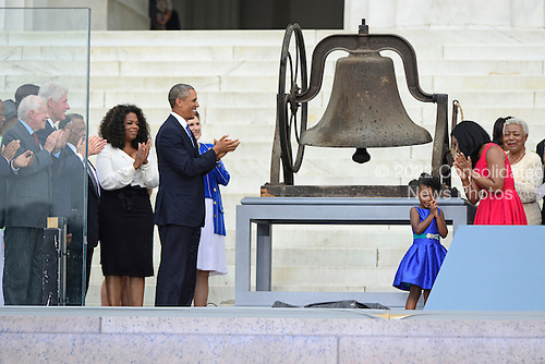 Former United States President Jimmy Carter, former U.S. President Bill Clinton, Ambassador Andrew Young, Oprah Winfrey, and U.S. President Barack Obama and Lynda Bird Johnson Robb applaud after members of the late Dr. Martin Luther King, Jr's family ring the bell from the 16th Street Baptist Church in Birmingham, Alabama at the Let Freedom Ring ceremony on the steps of the Lincoln Memorial to commemorate the 50th Anniversary of the March on Washington for Jobs and Freedom.<br /> Credit: Ron Sachs / CNP