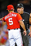 28 August 2010: Washington Nationals Manager Jim Riggleman listens to umpires explain a baserunning call on Ian Desmond during play against the St. Louis Cardinals at Nationals Park in Washington, DC. The Nationals defeated the Cards 14-5 to take the third game of their 4-game series. Mandatory Credit: Ed Wolfstein Photo