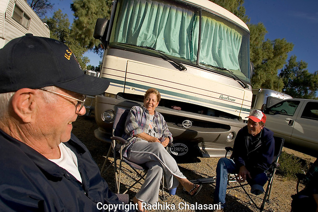 "ANDRADE, CA, U.S.-March 24: Tom Parker (L) ,70,Angela Key (C), 60 and her husband John, 70 enjoy the morning sunshine outside Parker's RV just down the road from the border crossing to Algodones, Mexico march 24, 2005. All three have had medical treatment in Algodones. Angela Key said, ""I'd love for the people that decide what they give you [for retirement] to try live on what we get."" Visiting Algodones helps them make ends meet.  ©Radhika Chalasani"