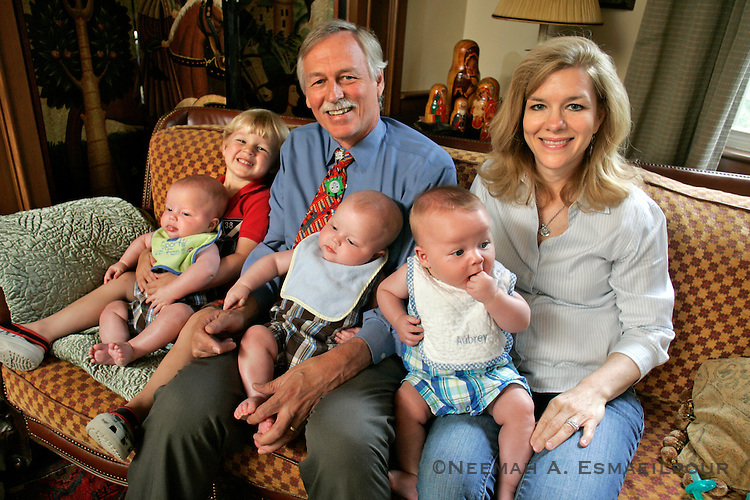 US Congressman Vic Snyder and his wife Betsy Singleton at their home in Little Rock, Arkansas with their four children. The triplets were a result of an in-vitro fertilization procedure. The two receive help from one of Snyder's congressional staffer's mother, Bobbye Nixon.