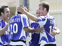 b42e50807 9 April 2005  SJ Earthquakes  Brad Davis celebrates with Ronald Cerritos  and Wade Barrett