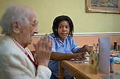 A Job Seekers Allowance claimant on a compulsory four week unpaid work placement in a private care home in Middleton, Rochdale, part of a Mandatory Work Related Activity welfare-to-work programme.