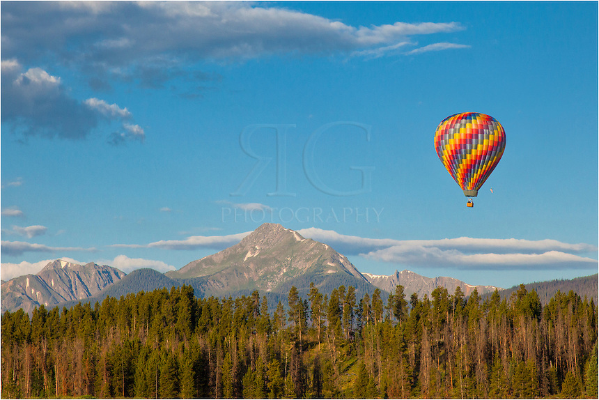 Nearly every morning in the summer when the winds and weather cooperate, you can find hot air balloons lifting off in the early morning hours and drifting across the Fraser River Valley. This image of Colorado shows the most distinct peak in the area, Byers Peak, in the distance.