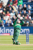 Mehedi Hasan Miraz (Bangladesh) puts everything into this drive down the ground and collects four runs during England vs Bangladesh, ICC World Cup Cricket at Sophia Gardens Cardiff on 8th June 2019