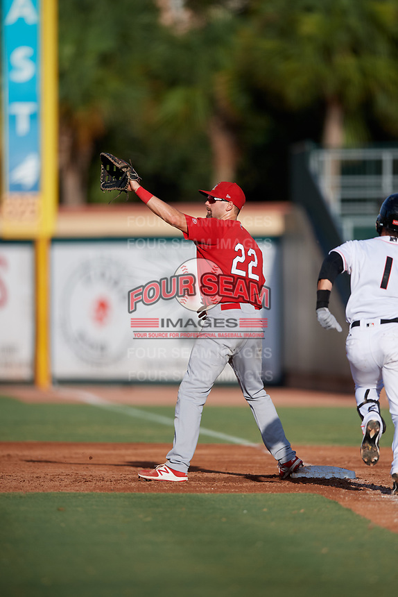 Palm Beach Cardinals first baseman Stefan Trosclair (22) waits to receive a throw as Bryson Brigman (1) runs down the first base line during a game against the Jupiter Hammerheads on August 4, 2018 at Roger Dean Chevrolet Stadium in Jupiter, Florida.  Palm Beach defeated Jupiter 7-6.  (Mike Janes/Four Seam Images)