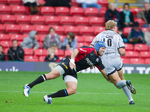 03.10.2010 Leicester Tigers Billy Twelvetrees (10) evades the tackle of Saracens' Schalk Brits. Saracens vs Leicester Tigers, Aviva Premiership, Vicarage Road  Result: 26-20.