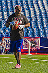 12 October 2014: Buffalo Bills running back C.J. Spiller listens to music as he warms up prior to a game against the New England Patriots at Ralph Wilson Stadium in Orchard Park, NY. The Patriots defeated the Bills 37-22 to move into first place in the AFC Eastern Division. Mandatory Credit: Ed Wolfstein Photo *** RAW (NEF) Image File Available ***