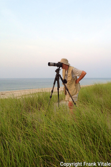 Preparing to photograph a brilliant Cape Cod sunset. At the edge of the Province Lands Dunes, sunrise begins with the sun coming out of the water and sunsets with the sun boiling back into the water - an unusual sight on the east coast or anywhere.