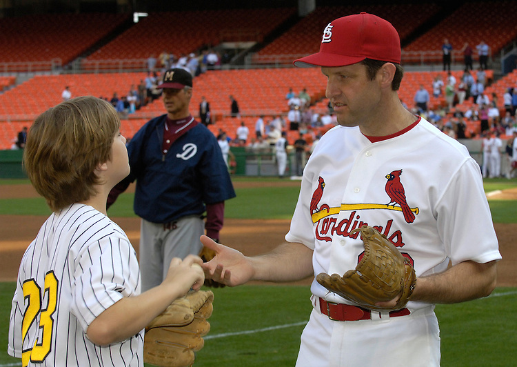 Russ Carnahan gets some pointers from his son Andrew age 11 before the start of the 44th Annual Roll Call Congressional Baseball Game at RFK Stadium in Washington D.C.