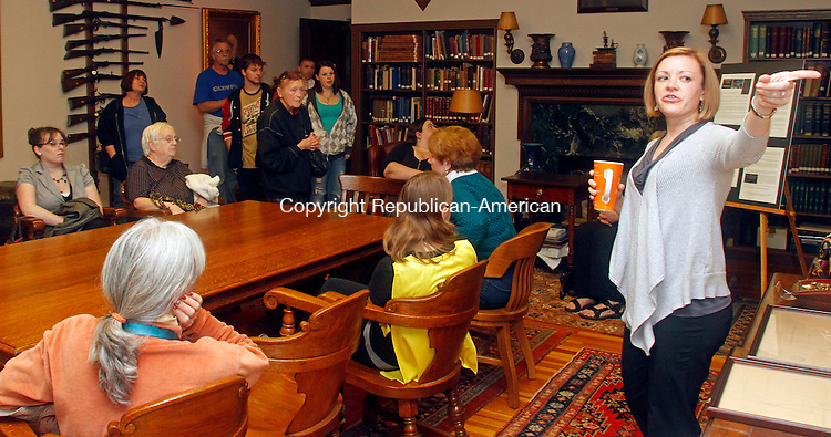 Torrington, CT- 30 October 103014MK02 Jessica Hodorski, Program Coordinator and Teen Services, (right) lead a group of about fifteen people on a haunted library tour Thursday evening at the Torrington Library. Hodorski guided the guests through the stacks while describing legends and lore of literature's scary stories as well as ghost stories from happenings in the building. Michael Kabelka / Republican-American