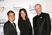 BURBANK - APR 27: Steve Lee, Kathleen Cahill, Monsignor Gregory Cox at the Faith, Hope and Charity Gala hosted by Catholic Charities of Los Angeles at De Luxe Banquet Hall on April 27, 2019 in Burbank, CA