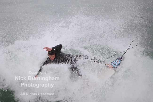Towan Beach, Newquay, Cornwall, August 4, 2015.  Heavy surf attracts large numbers of surfers of all ages to Newquay's Towan Beach. Newquay is widely regarded as the surfing capital of Britain.
