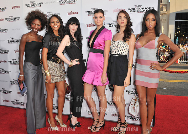 """Project Runway Models Fatma Dabo (left), Ebony Jointer, Kojii Helnwein, Lisa Blades, Katie Sticksel & Tamisha Harper at the Los Angeles premiere of """"Inglourious Basterds"""" at the Grauman's Chinese Theatre, Hollywood..August 10, 2009  Los Angeles, CA.Picture: Paul Smith / Featureflash"""